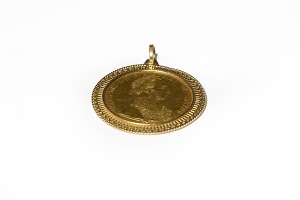 An Austrian 1915 4 Ducat coin mounted as a pendant, length 6.1cm . Gross weight 23.9 grams.