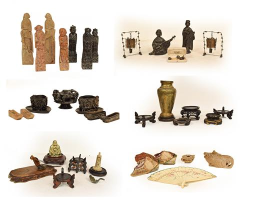 Two trays of Chinese and Japanese artifacts including soapstone carvings, one formed as a hen, a