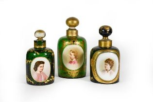 Three Differing Green Glass Scent-Bottles, each cylindrical and with gilt heightened decoration,