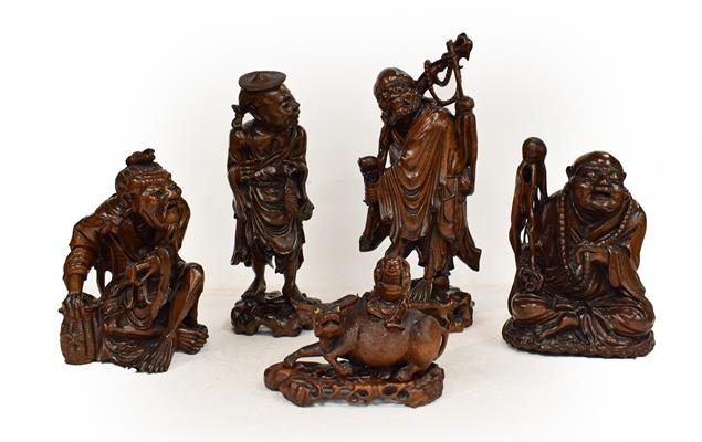 Five late 19th/early 20th century Chinese hardwood carvings, a fisherman, a nomad, water buffalo and