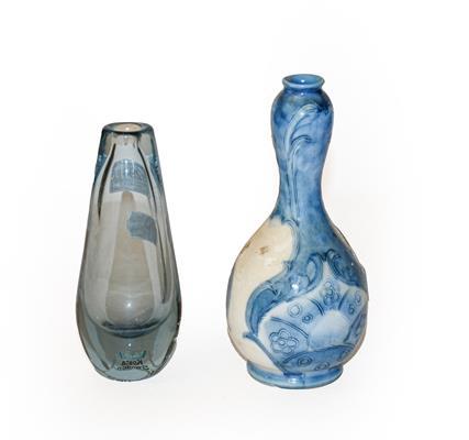 A Moorcroft Burslem pottery vase, 17cm (a.f.) together with a Kosta glass vase, Sweden, 15cm (2)