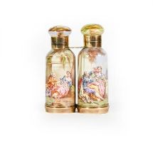 A Gilt-Metal Mounted Ceramic Double Scent-Bottle, each side tapering and decorated with figures in