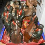 A painted resin six piece jazz band: a pianist, drummer, cellist, trumpeter, saxophonist and singer,
