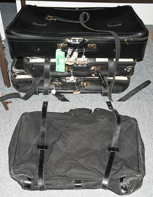 Two graduated black Tanner Krolle suitcases made for Harrods, the largest with canvas protector