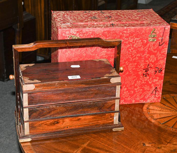 A 19th century Chinese rosewood three-tier picnic basket; together with a Chinese painted stand (2)