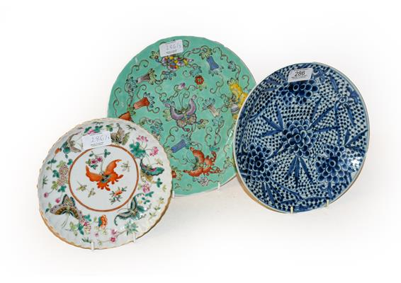 An early 20th century Chinese famille vert plate decorated with butterflies, a smaller famille