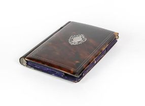 A Silver Inlaid Tortoiseshell Card-Case, oblong, the hinged cover with silver inlaid vacant