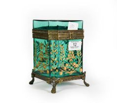 A Gilt-Metal Mounted Green Glass Casket, of octagonal section and on four paw feet, the glass panels
