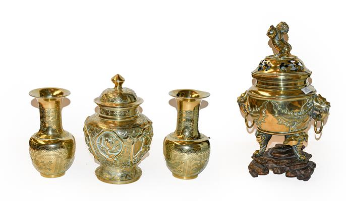 A large early 20th century Japanese brass koro and cover on tri-form hardwood stand, a similar jar