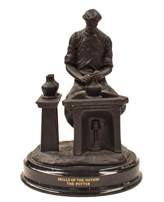 A Wedgewood black basalt figure, Skills of the Nation, The Potter, in original box with certificate