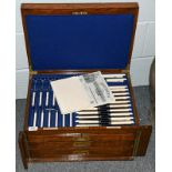 A Goldsmith's & Silversmith's Company Ltd oak cased three drawer canteen containing a complete