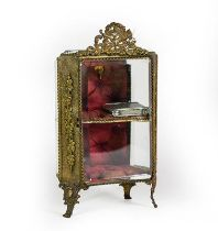 A Gilt-Metal Mounted Miniature Display Cabinet, on scroll feet, with ribbon-tied love trophy finial,