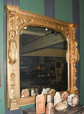 A gilt framed over mantle mirror, the frame carved with caryatids, 127cms by 131cms