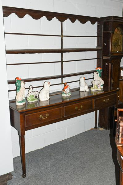 A George III open dresser and rack, 3rd quarter 18th century, the rack with moulded wavy shaped