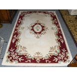 An Indian rug, the ivory field with floral medallion framed by borders 24cm by 152cm