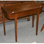 A George III mahogany fold over tea table with ebonised stringing, 89cm by 43cm by 74cm
