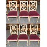 A set of six 20th century Empire style Continental white painted lyre back chairs