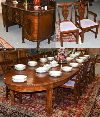 A Victorian style dining suite comprising a mahogany 14ft draw leaf dining table with four