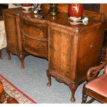 A reproduction burr walnut sideboard 165cm by 66cm by 114cm