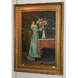 W Mander (Contemporary) A lady arranging flowers in an interior, signed oil on canvas, 90cm by 60cm