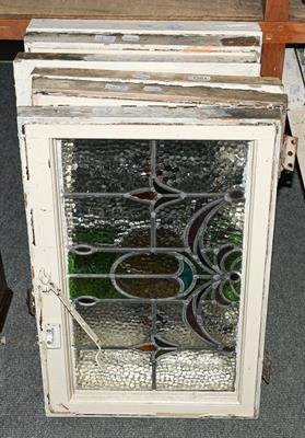 A set of six leaded and coloured glass windows in white painted frames, circa 1900/1910, each 43cm