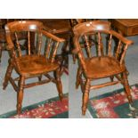 A pair of 19th century yew wood smokers chairs with twin stretchers and turned supports (2)0