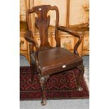 A 19th century style mahogany open armchair on shell carved legs and pad feet