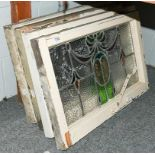 A set of four leaded and coloured glass windows in white painted frames, circa 1900/1910, each