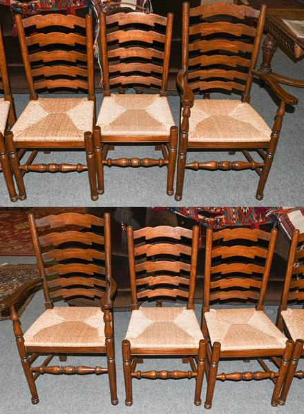 A set of six oak ladder back rush seated dining chairs, including two carvers (6)