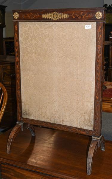 A 19th century inlaid and gilt metal mounted fire screen, 64cm by 98cm