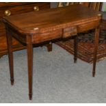 A George III crossbanded mahogany fold over tea table, 92cm by 45cm by 73cm