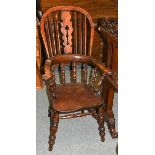 A 19th century yew and elm Windsor chair