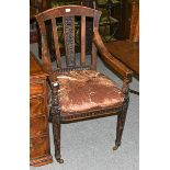 An early 20th century oak judges chair