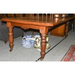 A Victorian oak wind-out dining table with two additional leaves, 243cm (open) by 120cm, 74cm high