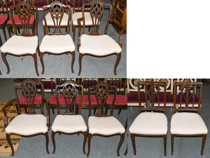 A set of six mahogany dining chairs including two carvers, together with a further pair of dining