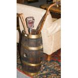 Brass bound oak barrel converted to a stick stand together with four walking sticks and a shooting