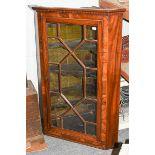 A Georgian inlaid mahogany glazed corner cupboard, 80cm by 50cm by 115cm