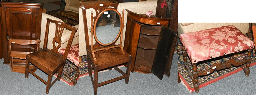 A group of furniture comprising two 18th century oak chairs, a Geogre III mahogany bow-front hanging