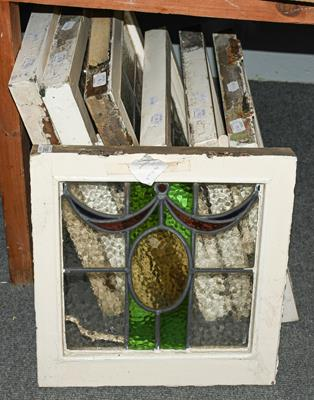 A group of seven leaded and coloured glass windows in white painted frames circa 1900/1910,
