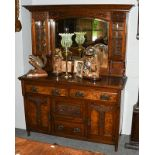 An early 20th century Arts & Crafts oak and walnut mirror-back sideboard, 142cm by 56cm by 188cm