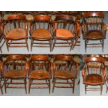 Six spindle Captains chairs and a pair of armchairs