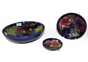 Three Moorcroft bowls, Cobalt blue ground, Clematis and Anemone pattern, the largest 26.5cm