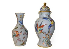 A late 20th century Limoges large baluster vase and cover, grey ground and enamelled with exotic