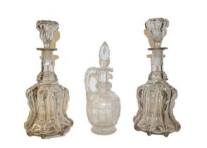 A pair of ship decanters, together with a pair of Victorian mallet form decanters, and a glass