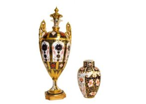 A Royal Crown Derby twin handled vase in Imari pattern (a.f.) and a small vase and cover (2). Larger