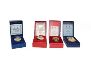 A collection of eighteen Halcyon Days enamel boxes - cased, a Continental porcelain figure group,