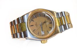 A stainless steel and gold plated automatic calendar centre seconds wristwatch, signed Eterna Matic,