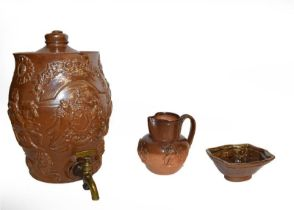 A quantity of brown and salt glazed stoneware including a spirit barrel sprigged with the Royal