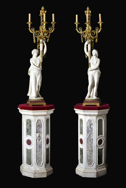 A Pair of French Ormolu-Mounted, White Marble and Porphyry Candelabra, signed Joan F.R. Lorta,