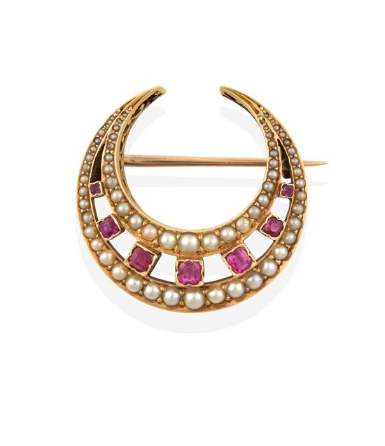 An Edwardian Synthetic Ruby and Split Pearl Crescent Brooch, seven graduated round cut synthetic